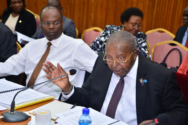 Bank of Uganda (BoU) Governor Emmanuel Mutebile and his deputy, Louis Kasekende. High Court has issued ghanishee order against BoU, dfcu Bank  (FILE PHOTO)