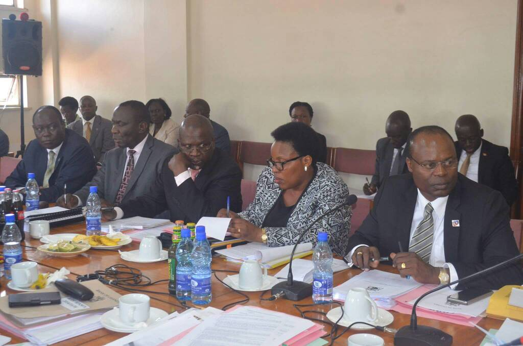 Officials from Bank of Uganda including Deputy Governor Louis Kasekende appearing before the COSASE on Tuesday. They are set to reappear as the cross examination enters Week three (PML Daily photo)