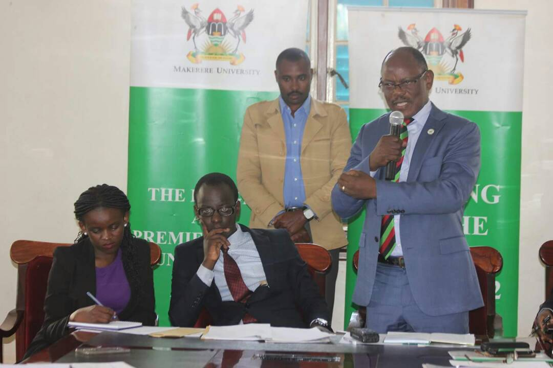 MUK Guild President Papa Were looks on as Vice Chancellor, Prof Barnabas Nawangwe (R) speaks at a meeting recently. Students have vowed to petition the university in the High Court if the 15%tuition fee increment is not addressed (FILE PHOTO)
