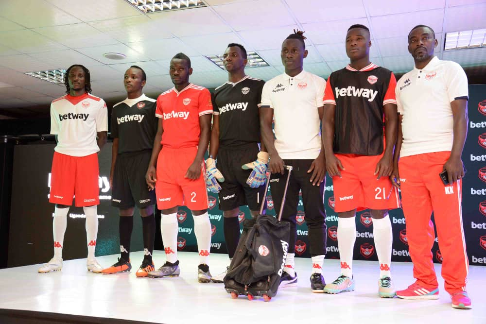 Express FC players and staff modeling the new kit on Tuesday (Photo by Shaban Lubega)