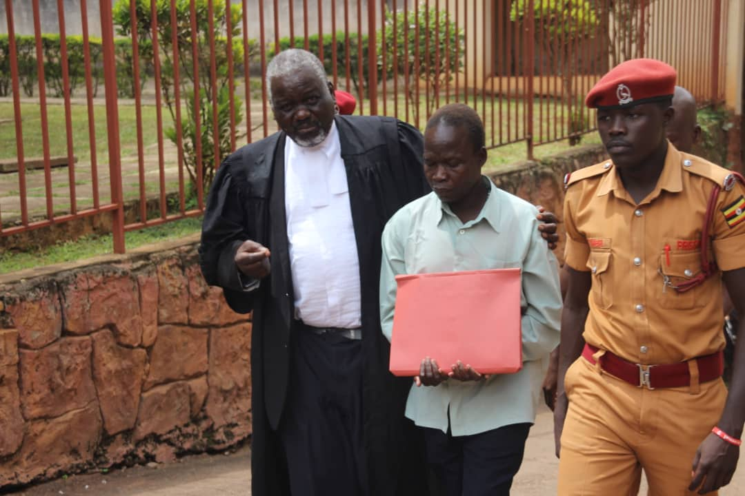 Kwoyelo with his lawyer Mr Oponya. He has denied all the counts (FILE PHOTO)