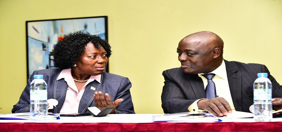Kadaga(L) interacts with Agric Minister Hon Ssempijja at the Livestock project launch at Imperial Royale Hotel (PARLIAMENT PHOTO)