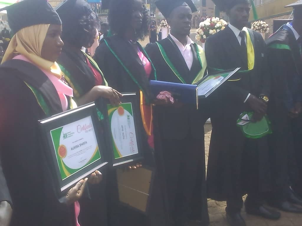 Some of the graduates who attained first class of education at KIU pose with their awarded certificates of merit. (Photo by Nelson Mandela)