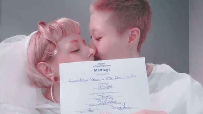 The Instagram picture of Etta Ng and Andi Autumn kissing and holding their marriage certificate