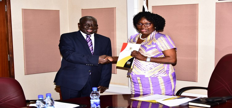 The Speaker(R) receives the PSC annual report from Justice Ochan