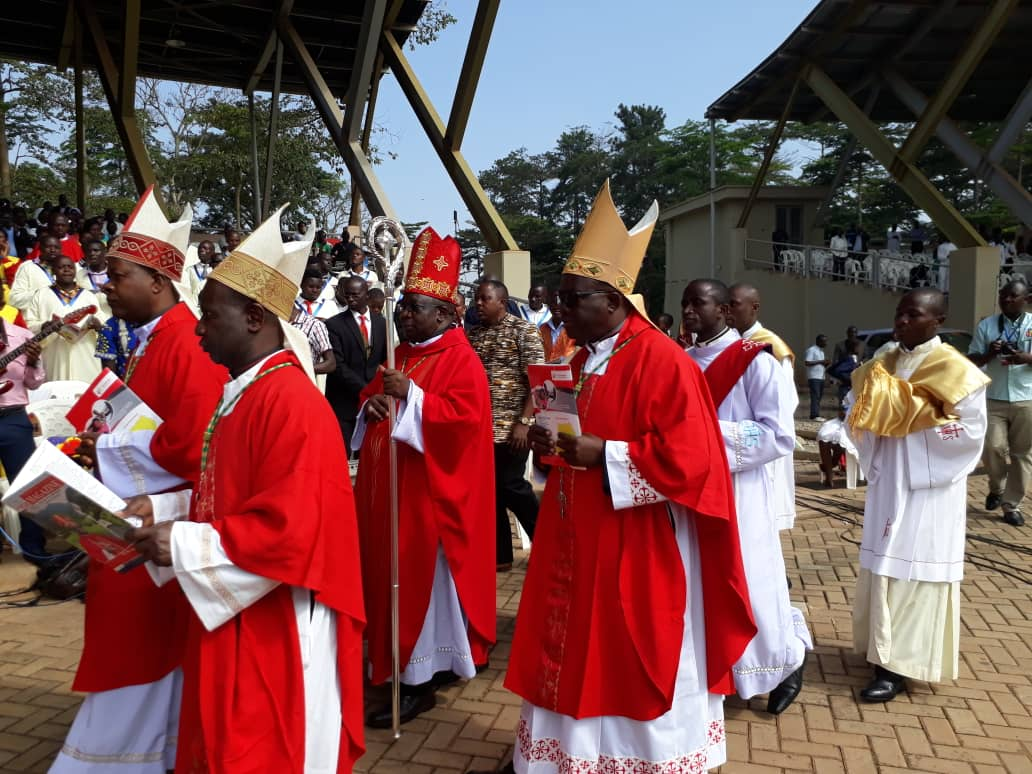 Bishop Francis Aquirinus Kibira leads other Bishops in the procession for Mass (PML Daily PHOTO)
