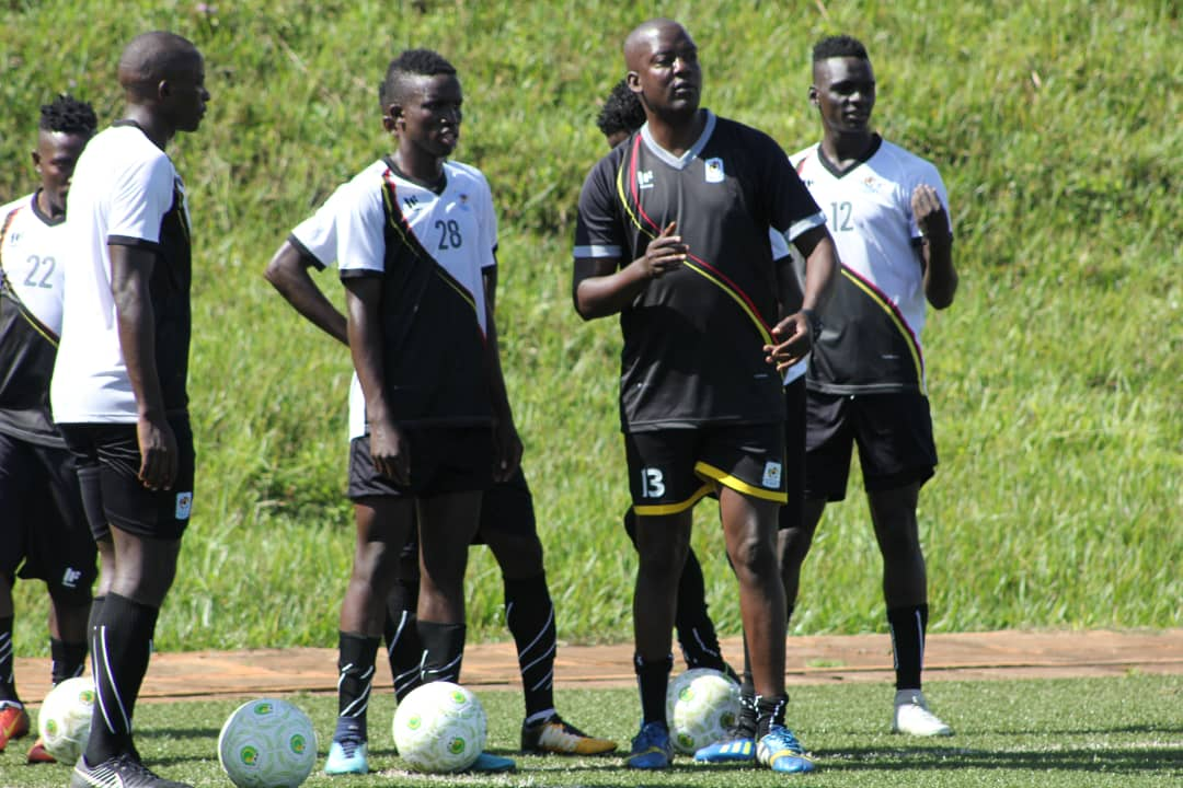 Coach Wasswa Bbosa (in black) conducting training in Njeru on Monday (Photos by FUFA Media)