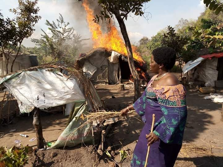 RDC Amuru Mego Auma Linda set fire on makeshift shelters of charcoal dealers. She join the fight to protect environment. Local leaders and general population of Amuru are excited with her leadership styles (Photo Credit: JULIUS PETER)