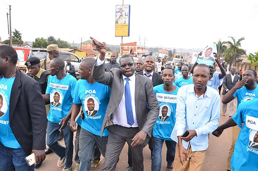 FDC party President Patrick Oboi Amuriat walks with youths recently. The opposition party have withdrawn their participation in the IPOD summit. (PHOTO/File)