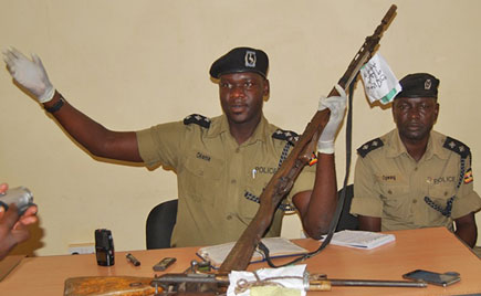 Aswa Regional Police Spokesperson, Patrick Jimmy Okema displays guns reconvered at a crime scene. Gun-related crimes are on the rise as govt moves carryout a firearm fingerprinting exercise(FILE PHOTO)