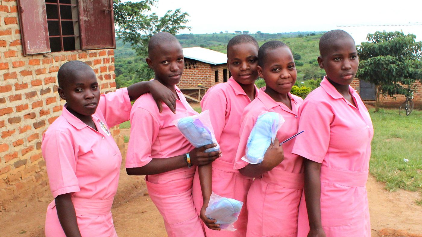 Girls hold reusable menstrual pads, which they received at school recently. (PHOTO/File)