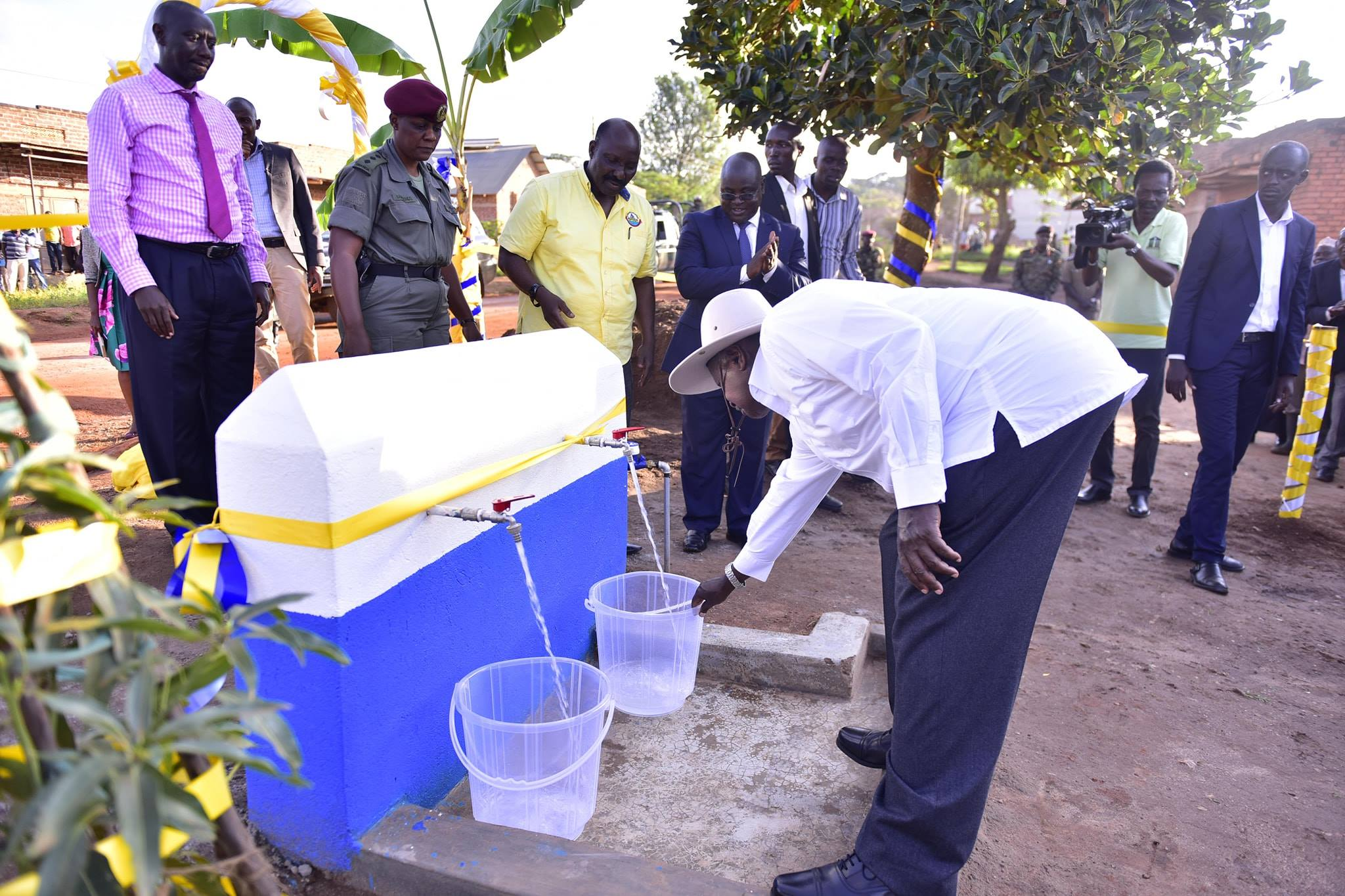 President Museveni commissions one of the 25 taps off the Kasswa-Senya-Bukoto water supply project in Lwengo District (PPU PHOTO)