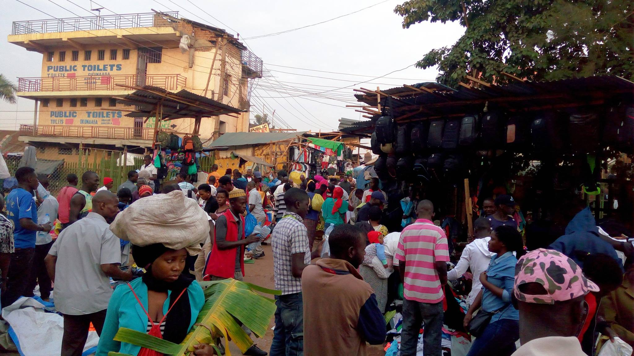 People in Kampala flock Owino Market as early as 7:00 am to shop items at wholesale prices (Photo by Maurice Muhwezi)