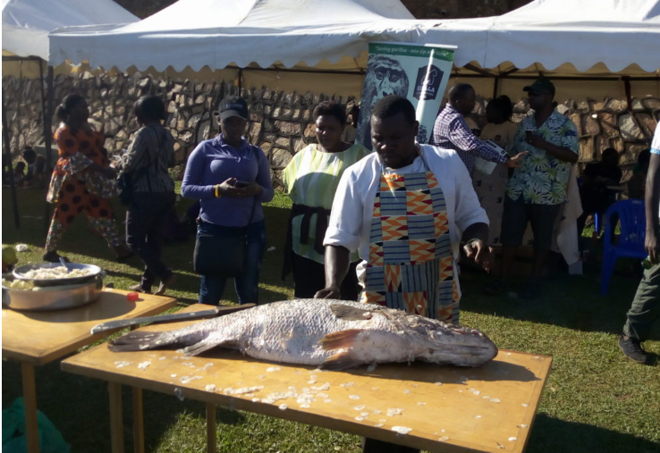 An Exhibitor at the stall with the Empuuta. (PHOTO BY ABRAHAM MUTALYEBWA)
