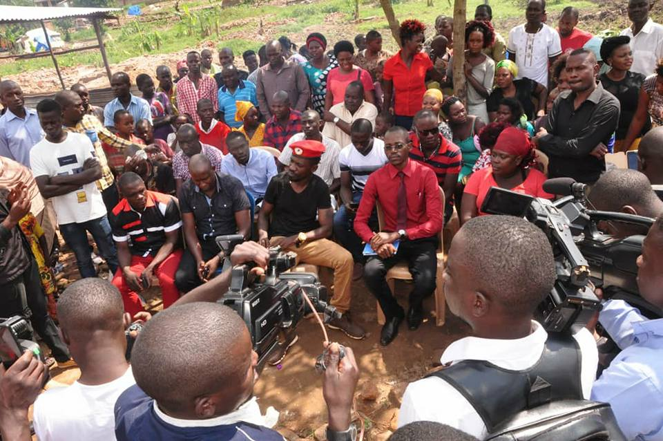 Kyadondo East MP Robert Kyagulanyi aka Bobi Wine speaks to the Lusanja residents; land eviction victims Monday December 24 (PML Daily PHOTO)