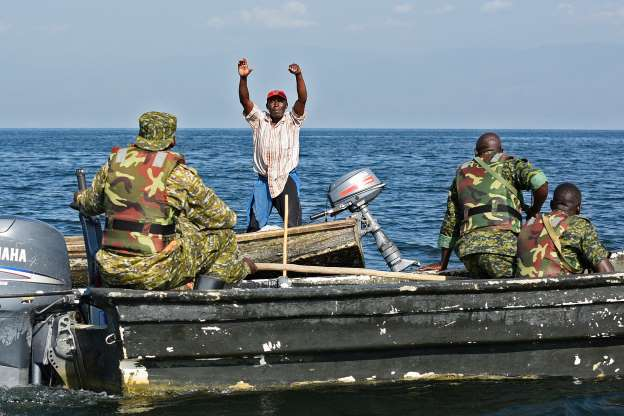 A fisherman raises his hands up to surrender. (FILE PHOTO)