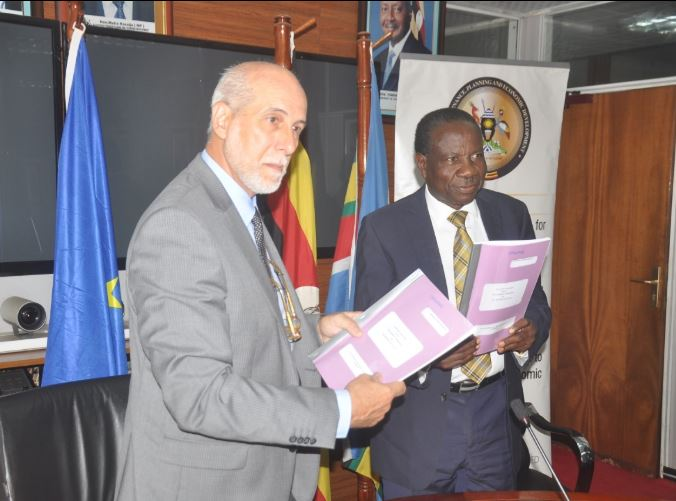 EU Head of Delegation to Uganda, Amb. Attilio Pacifici and Finance Minister, Matia Kasaija signed off the partnership to benefit the farmers in the export business (PML Daily PHOTO)