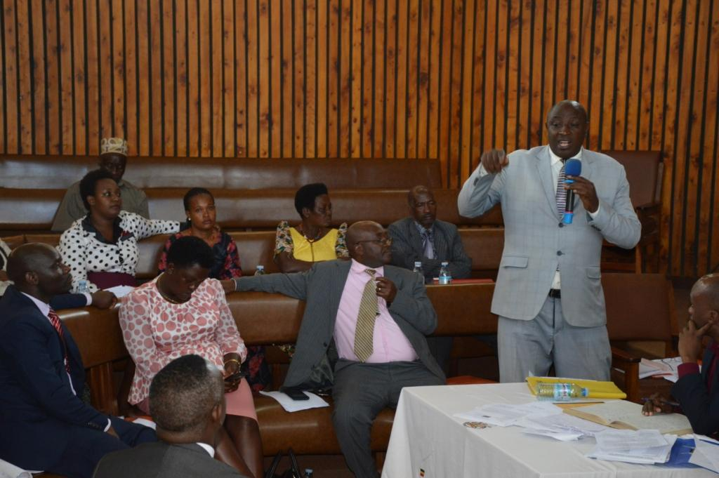 Godfrey Baryomunsi the LCV Vice chairman speaking during the council meeting.