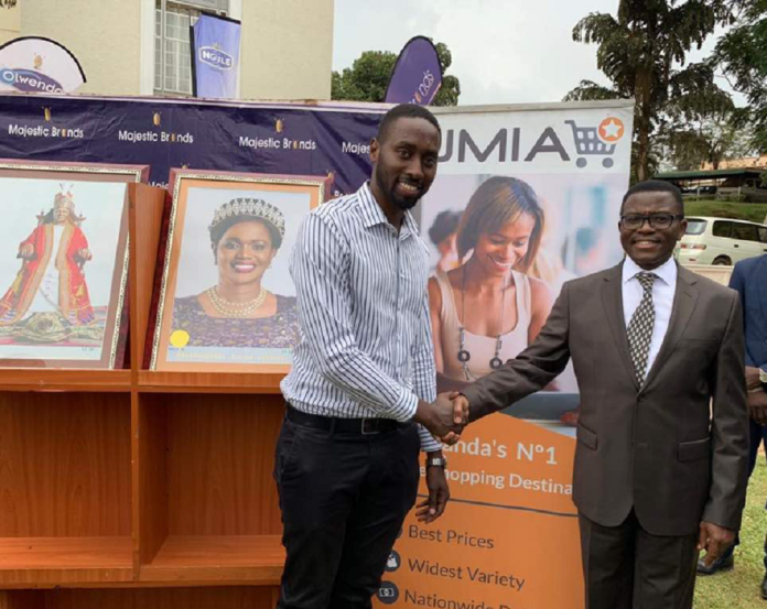 Jumia Uganda CEO Ron Rwakamara (Left) and Buganda Kingdom Katikkiro Charles Peter Mayiga during the partnership (PML Daily Photo)