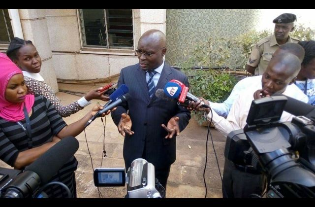 Justice Simon Byabakama, the chairman EC addresses journalists outside the conference room at hotel Africana after the roadmap