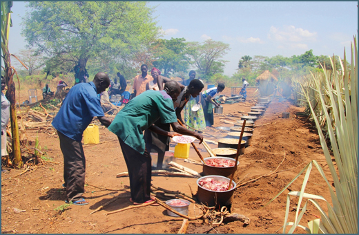 Lango tribe cooks prepare food for Christmas celebrations.