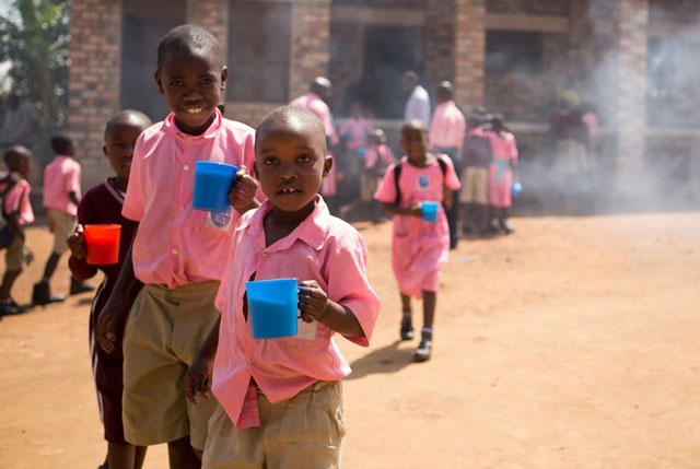 Pupils share porridge at their school. A report has revealed that over 65% of school going children drop-out of school as a result of gender-based violence in areas of Mbarara and greater Bushenyi (FILE PHOTO)