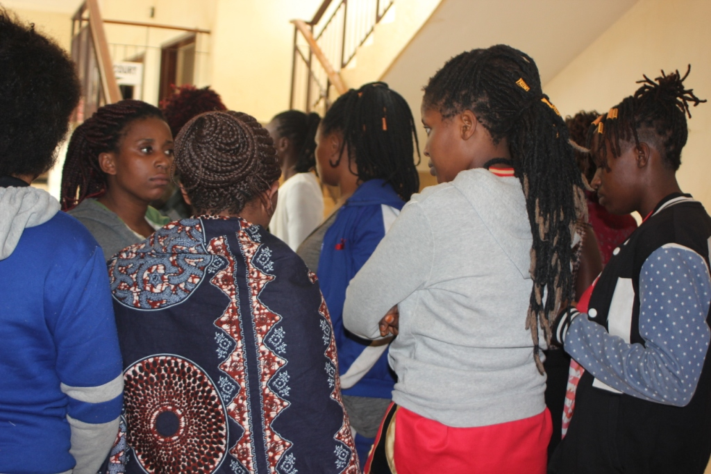 Nine women gathered outside court room before being handed over to prison wardens (2)
