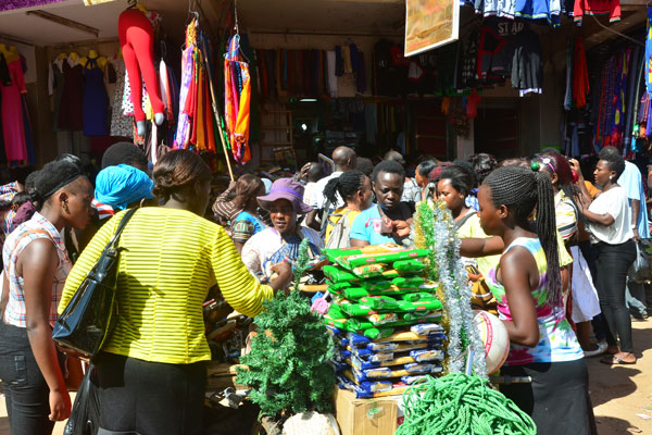 Shoppers buy assorted items ahead of Christmas in Kampala