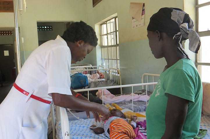 Sr Immaculate Akello, the hospital's senior nursing officer, checks on a child during her rounds in the children's ward. On another note, people in Katakwi have slammed health workers citing that they ask for bribes before attending to them (FILE PHOTO)