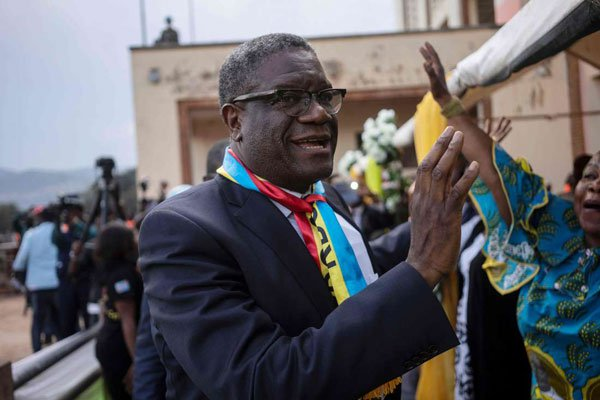 The 2018 Nobel peace laureate, Dr Denis Mukwege, is welcomed before addressing the crowd on December 27, 2018 in Bukavu, as he returns in RDC for the first time since receiving the award.