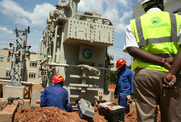 Umeme technicians erect power transformers in Tororro sub region recntly (FILE PHOTO)