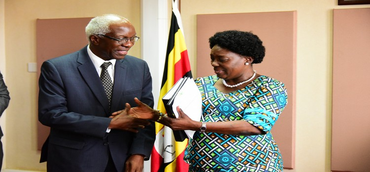Auditor General John Muwanga hands over an audit report for the year 2018 to the Speaker of Parliament Rebecca Kadaga