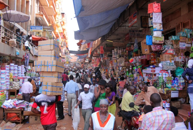 Traders goes about their businesss in Kikuubo, Kampala. City traders have cry foul for the high garbage collections fees and petition President Museveni for intervention (FILE PHOTO)
