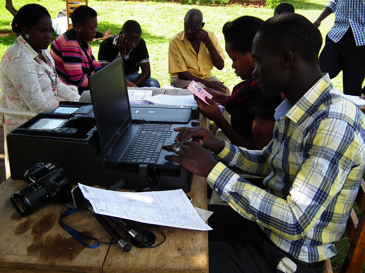 A NIRA official registers populates National register details of a citizen (PHOTO/File)