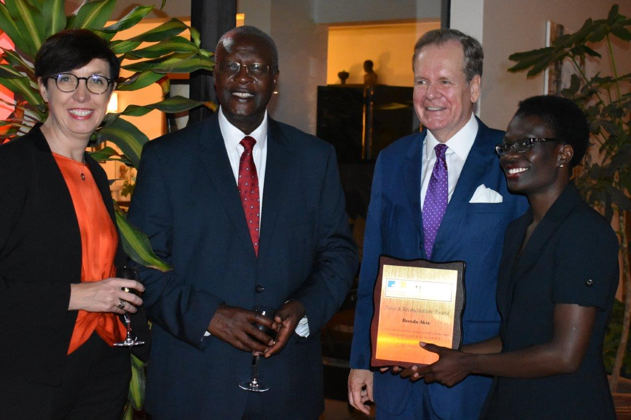 Left  French Ambassador Stephanie Rivoal, Chief Justice Bart Katureebe , Albrecht Conze German Ambassador and Brenda Akia winner of the of the Award.( PHOTO BY ABRAHAM MUTALYEBWA)