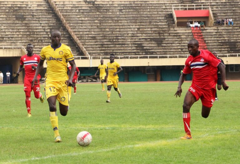 Kulaba (right) in action for URA FC a few seasons ago (Photo by Agency)