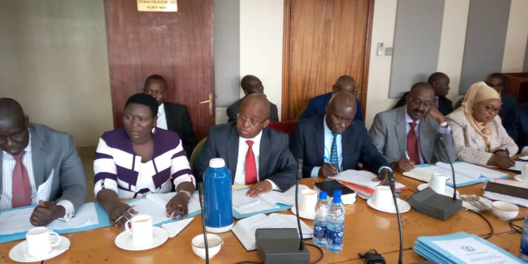 EC officials Justice Simon Byabakama and Sam Rwakoojo at Parliament. Legislators on the Committee of Legal and Parliamentary Affairs have tasked the Electoral Commission to justify the Shs428.801bn required for 2021 general elections. (FILE PHOTO)
