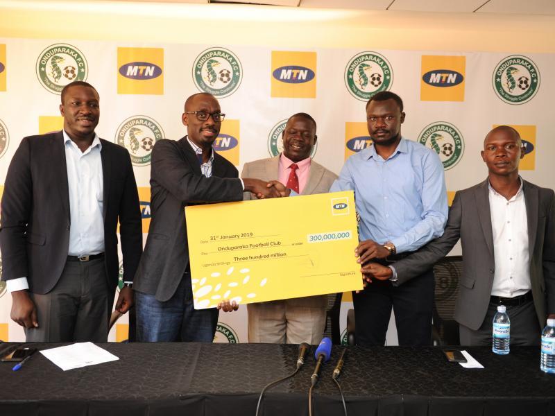 MTN Uganda and Onduparaka officials at Kololo on Thursday (Agency Photo)