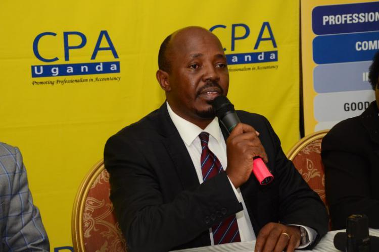 President ICPAU. Kibeddi addresses the media at Imperial Royale hotel recently (ICPAU PHOTO)