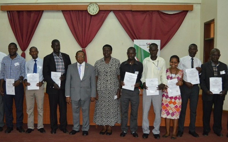 Some of the participants posing for a photo with the Chancellor of Makerere University Prof Ezra Suruma and the Director for Education Standards in the Ministry of Education and Sports Dr. Kedress Turyagyenda after recieving their certificates. (PML PHOTO)