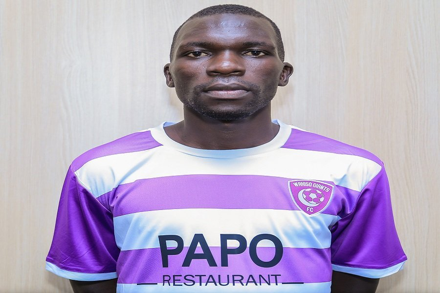 Ojik poses in a Wakiso jersey after signing a three year deal (Photo by Wakiso Media)