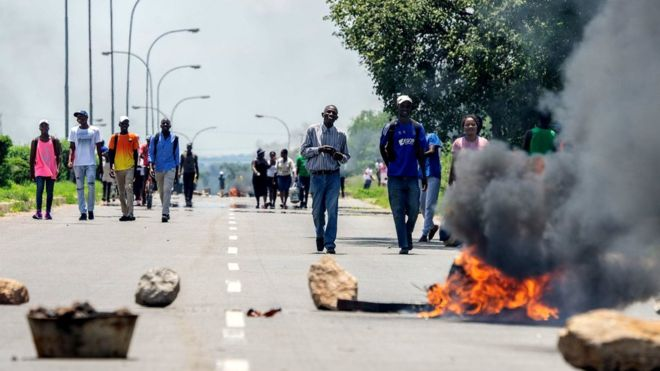 Protesters in Zimbabwean capital, Harare. The unrest in Zimbabwe is beginging to affect business operations in neighbouring countries such as Malawi and South Africa. (GETTY PHOTO)