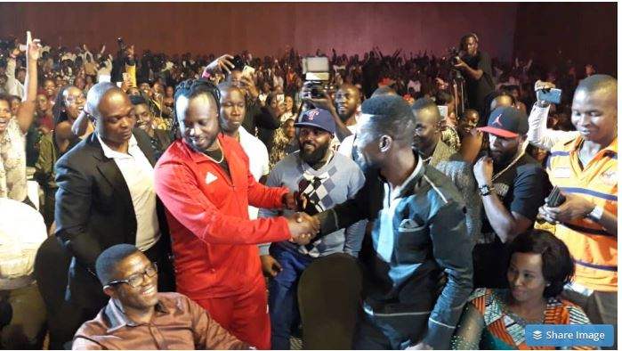 Bobi Wine shakes with his long term rival Bebe Cool at Kenzo's concert on Friday. PML Daily PHOTO)
