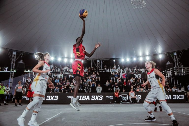 Asinde (center) representing Uganda at the 2018 FIBA 3×3 U23 World Cup (Photo by Agency)