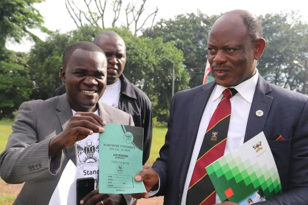 Makerere University Vice-Chancellor, Prof Nawangwe, and the suspended Muasa boss Dr. Deus Kamunyu recently. (PHOTO/File)