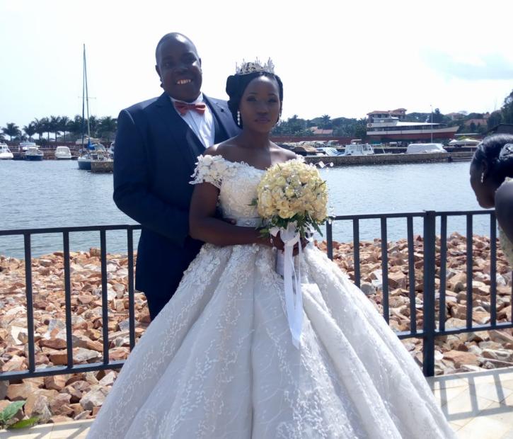 Ronald Sebuguzi and his newly wedded wife Susan Najjuka posing for a photo at Speke resort Munyonyo over the weekend.