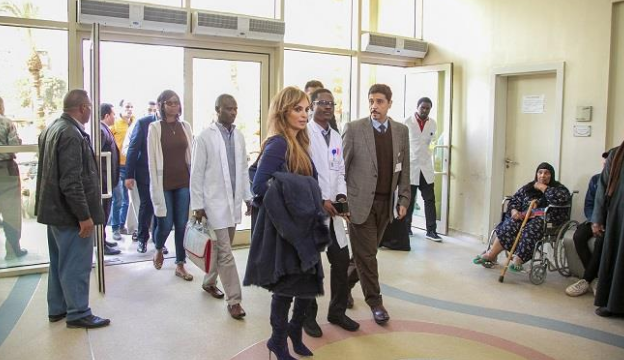 Dr. Rasha Kelej, CEO of Merck Foundation entering the National Cancer Institute along with alumni students from Ghana, Namibia, Liberia and Rwanda
