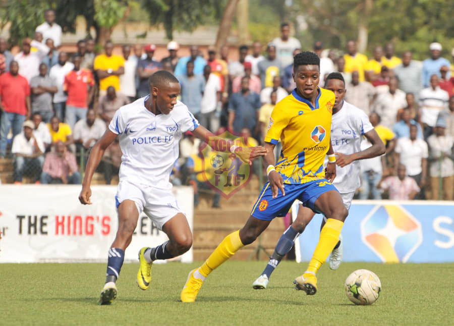 KCCA's Allan Okello (right) in action against Police on Thursday afternoon (Photo by KCCA FC Media)