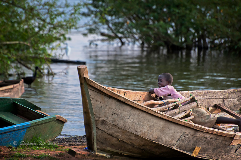 Young boy playing in idle fishing boat. Lake Victoria, Mayuge District, Uganda. Boat owners have slammed the new URA tax amounting to shs.250,000 slapped on boats (FILE PHOTO)
