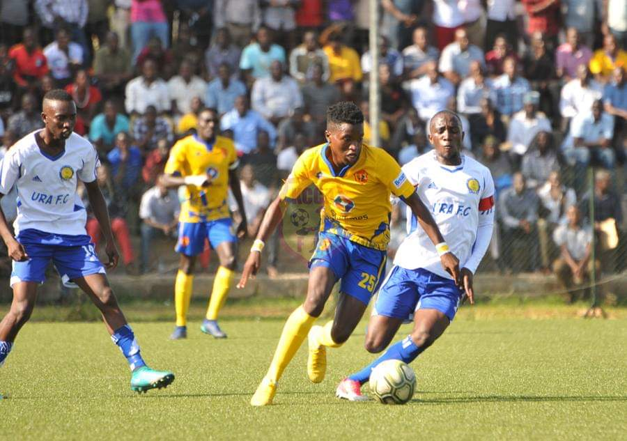 KCCA's Allan Okello dribbles past URA Captain Shafik Kagimu on Tuesday (PHOTO/ KCCA FC Media)
